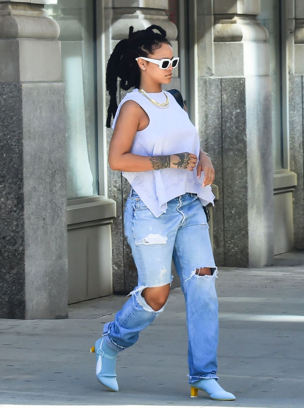 RIHANNA in Ripped Jeand Out in New York
